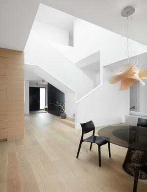 custom home with neutral colours and architectural lines with staircase