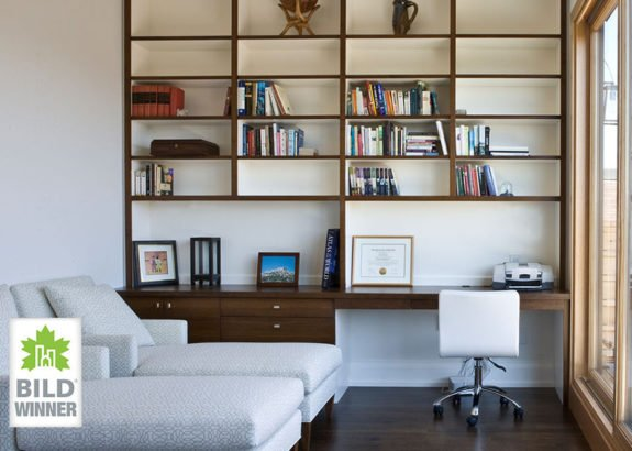 modern-office-space-with-floating-bookshelf-in-toronto