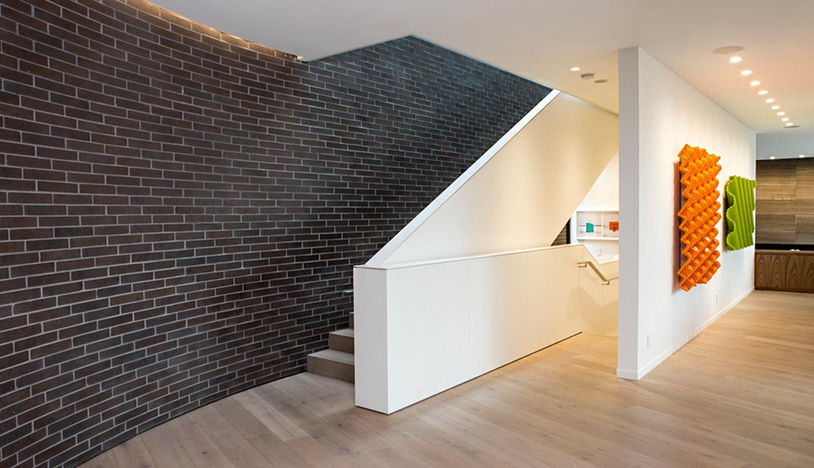 severnwoods-modern-rosedale-house-staircase-with-brick-walling