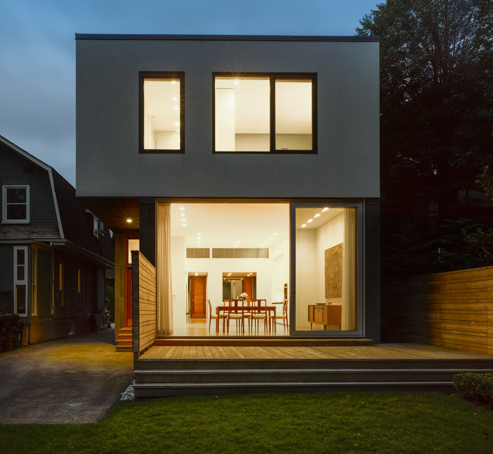 counterpoint-house-exterior-night-backyard-window-lit-house